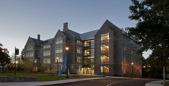 The Four Story Collegiate Gothic Style Building Features An Exterior Built From Granite Quarried Near Site